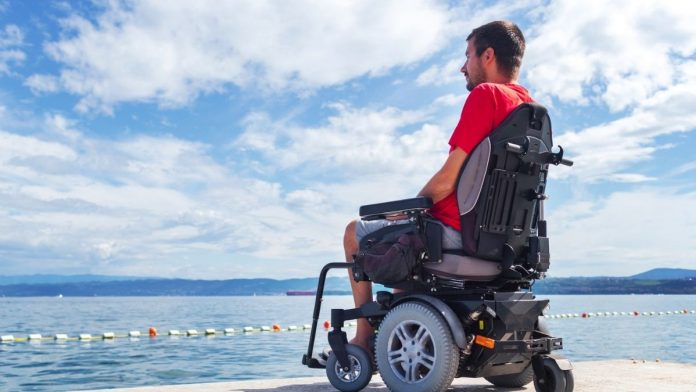electric wheelchair on the beach