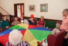 seniors playing parachute games